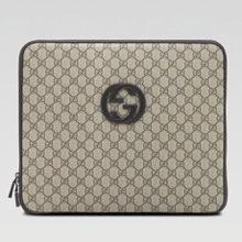 Лэптоп, одетый в Gucci